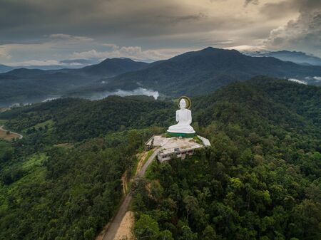 Aerial view of Big Buddha on mountaintemple. Tourist attraction landmark in Chiang Rai province of Thailand Stock Photo