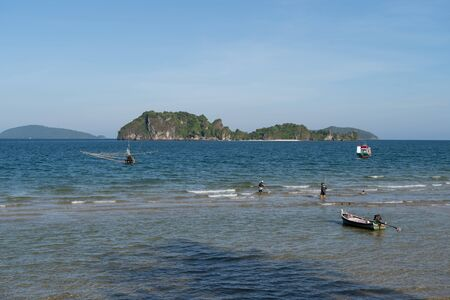 The beautiful landscape of fishing boat floating on sea,thailand.