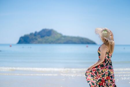 Beautiful young woman posing on the beach. Ocean, beach, sand, sky background, thailand.