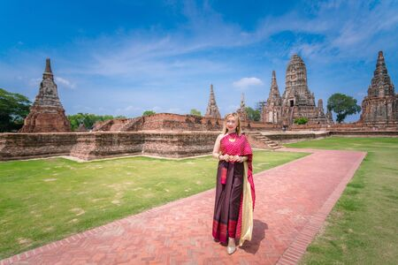 Young  woman is wearing Thai clothes in old temple, Thailand grand palace. Ayutthaya Thailand. Ayutthaya famous sightseeing plac.