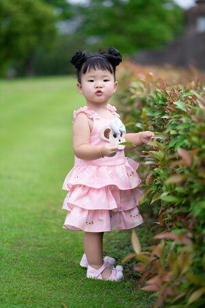 Happy kid girl having fun the natural park. Stock Photo
