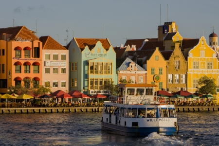 forground: Punda, Willemstad, Curacao  Forground with ferry  Background houses of Unesco World Heritage