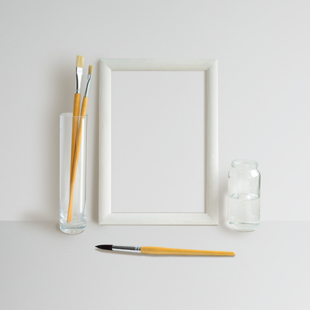 background pictures: Mock up with Frame and brushes on white background