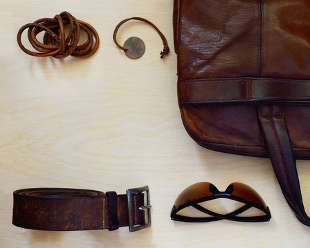 accessories: Man accessories on the light wood table