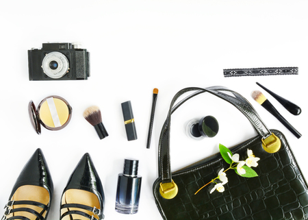 Retro Black Accessories. Flat lay with retro female bag, shoes and cosmetics. Vintage womans composition on white background Stockfoto