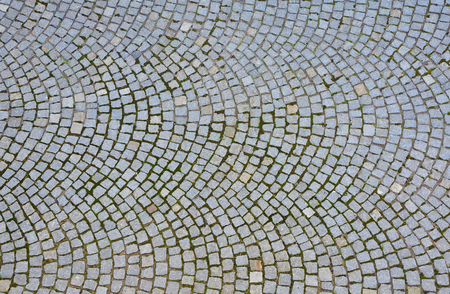 cobblestone road: Paving stone surface. Old cobblestone road with circular pattern. Top view.