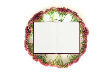 composition notebook: White notebook with flowers on white background. Flat lay composition. Mock up for art works. Stock Photo