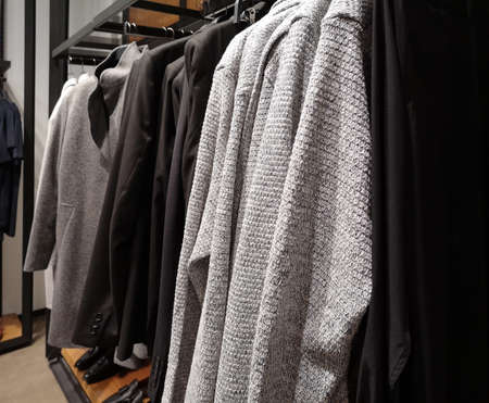 Row of clothes garment autumn and winter man fashion collection