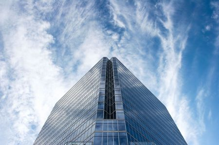 cirrus: Office tower set against deep blue sky with white cirrus clouds