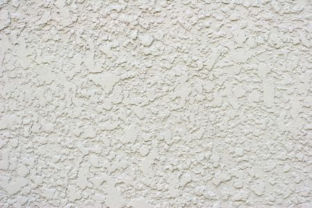 stucco: Textured White or Grey Stucco Wall With Small Crack Stock Photo