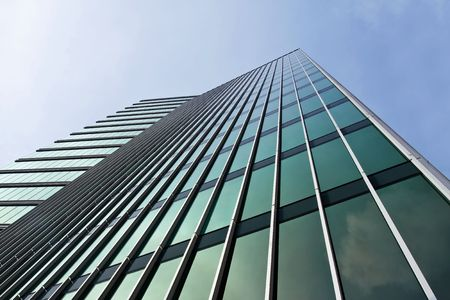Angular office tower with green windows against blue sky Stock Photo - 3733675