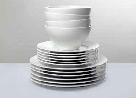 white washed: Commercial White Dishes Stacked with Neutral Background Stock Photo
