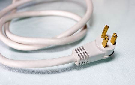 Coiled white computer power cord Stock Photo - 4882928