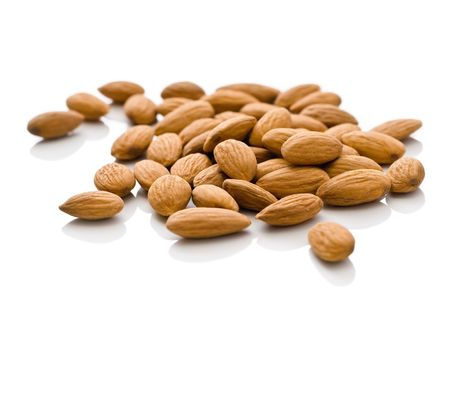 shelled: Shelled Whole Almonds on White Stock Photo