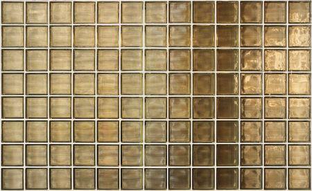 bathroom wall: Glass Block Wall With Irregular Gold Light Stock Photo
