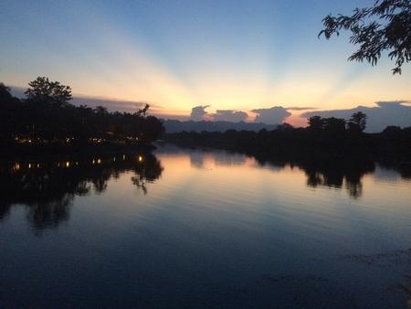 sunsets: Sunsets by river Kwai, Kanchanaburi, Thailand