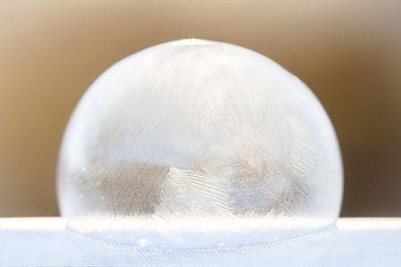Abstract icy, frozen soap bubble dome in winter