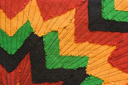 jamaican: Ornate fabric with versatile image as background