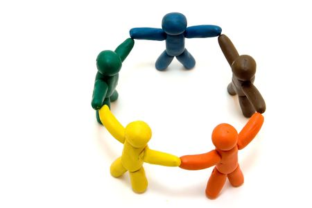 Multicolored clay people standing in circle isolated on white background photo