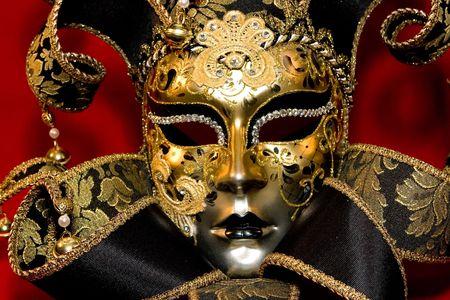 mardi gras mask: Ornate handmade venetian mask on red background