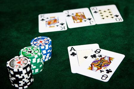 Poker table with chips and cards on it Stock Photo - 4456719