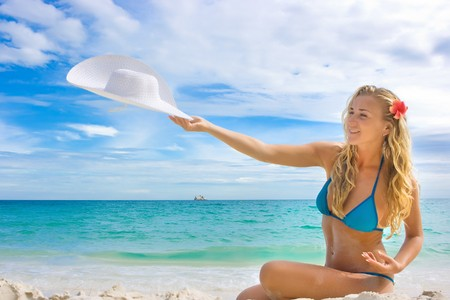 Happy girl with white hat on the beach Stock Photo