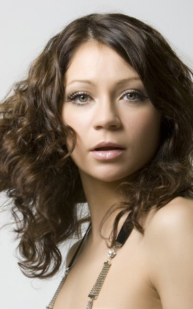 Close-up portrait of a beautiful young brunette in motion Stock Photo - 4483839