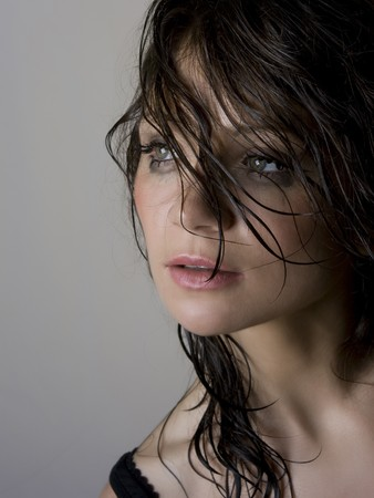 Close-up portrait of beautiful wet brunette