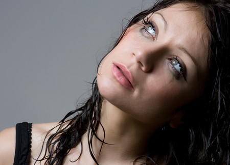 Beautiful wet brunette portrait in studio shot photo