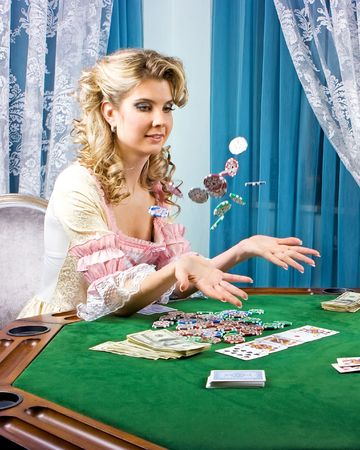 simultaneously: Poker girl loses and wins simultaneously in one game