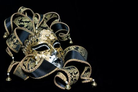 Ornate venetian mask lying on black background