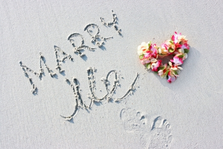 Hawaii flowers and marriage proposal sign on the beach