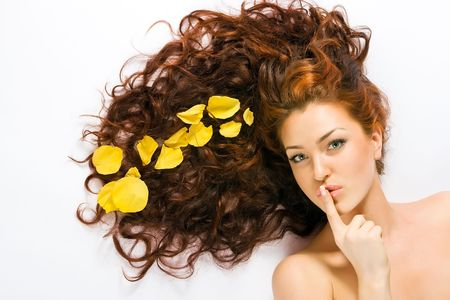 Beautiful red-haired girl lying on the floow Stock Photo