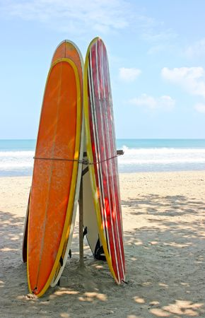 Surf boards standing on Kuta Bali beach photo