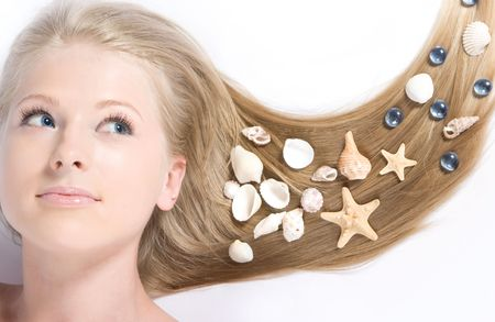 Close-up beautiful blond lying on white background with shell in her hair Stock Photo - 5136882