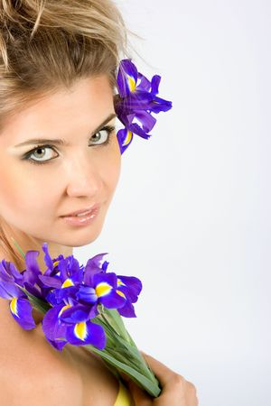Close-up fresh funny blond with beautiful make-up with iris flowers Stock Photo - 5136852