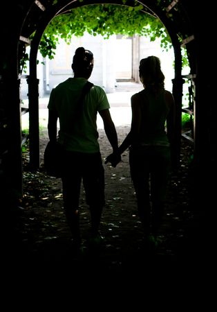 each: Two young lovers going hand by hand Stock Photo