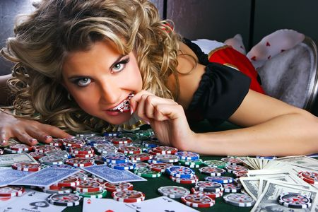 Poker girl with chip in her mouth Editorial