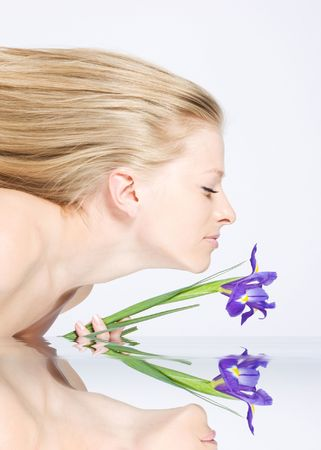 Beautiful fresh blonde lady with long hair and iris photo