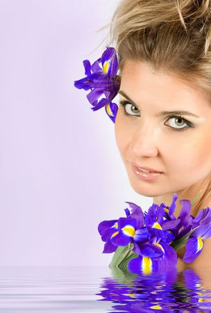 Close-up fresh funny blonde with beautiful make-up with iris flowers Stock Photo - 5153595