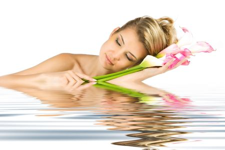 Blonde lady dreaming with gladious flowers in her hands photo