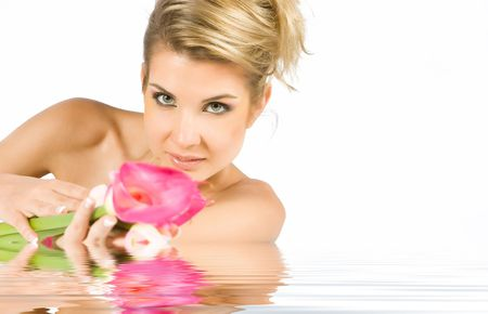 Blonde girl with gladiolus flower in hands isolated on white photo