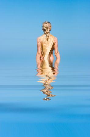 Blond beauty lady standing on the rocks Stock Photo
