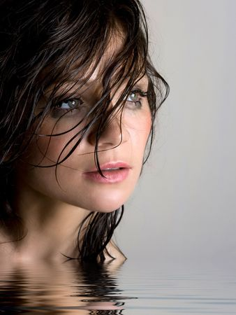 Close-up portrait of beautiful wet brunette photo