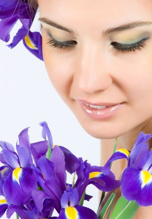 Close-up beautiful fresh young model with perfect make-up with purpur flowers photo