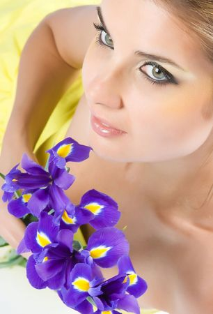 Close-up beautiful young model with perfect make-up with purpur flowers photo