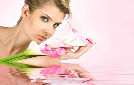 reverberation: Blonde girl with tulips in hands lying on the white floor