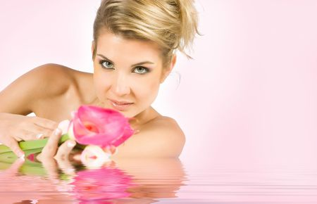 reverberation: Blonde girl with gladiolus flower in hands isolated on white