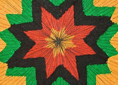 Multicolor rastaman fabric as background photo