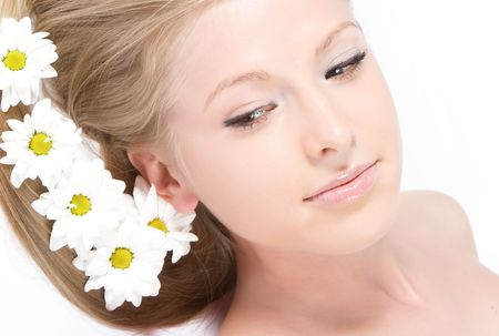 Close-up beautiful fresh young model with camomile flowers in hair photo